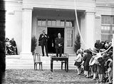 Picture relating to Ainslie - titled 'Sir John Butters speaking at the opening the Ainslie School in September 1927, with the Rt Hon Stanley Melbourne Bruce.'
