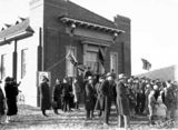 Picture relating to Braddon - titled 'Opening of Salvation Army Hall by Sir John Butters and dedicated by Commissioner Charles Sowton on 6 July 1929 at Eloura and Fawkner Streets, Braddon - bands and spectators.'