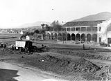 Picture relating to Canberra - titled 'Part of Sydney Building Civic Centre under construction, from Melbourne Building showing Keystone steam shovel excavating Northbourne Avenue, left background is Canberra Times, Meyers Bakery, T. J. Sheeky, Cordial Factory in Mort Street Ainslie.'