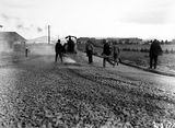 Picture relating to Canberra - titled 'Road making in Mort Street, South from Canberra Times Office - Civic Centre buildings in the background.'