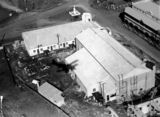 Picture relating to Murgon - titled 'Aerial view of construction of the Public Hall and commercial buildings, Murgon, 1938'
