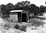 Picture relating to State Circle - titled 'The Surveyors hut on State Circle - Originally Federal Capital Survey Camp established in 1909. It is one of the oldest Commonwealth buildings in the ACT. Charles Robert Scrivener, surveyor, used this hut for secure storage of survey documents.'
