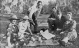 Picture relating to Cloncurry - titled 'Members of the Royal Flying Doctor Service and friends picnicing at Cloncurry, 1937'