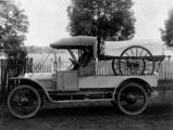 Picture relating to Queensland - titled 'Early motor ambulance carrying a two wheeled covered stretcher, 1910-1920'