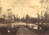 Picture relating to Ipswich - titled 'Floodwaters in Brisbane Road Ipswich, January 1887'