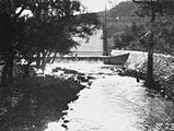 Picture relating to Cotter River - titled 'Cotter Dam Wall overflowing into the stilling pond and into the Cotter River'