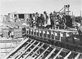 Picture relating to Kingston - titled 'Manuka swimming pool, under construction, pouring concrete for the walls, Manuka Circle, Kingston.'
