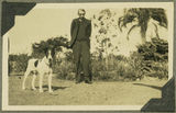 Picture relating to Rockhampton - titled 'Archdeacon G. H. Rogers and his dog Patch, ca. 1925'