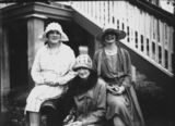 Picture relating to Queensland - titled 'Three women posing at the bottom of the stairs of a Queenslander house, 1920-1930'
