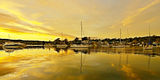 Picture relating to Lake Macquarie - titled 'Golden Reflections Waterscape Sunrise with Boats Lake Macquarie'