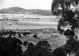 Picture relating to Capital Hill - titled 'View looking north, from Red Hill over Forrest showing East-Block, Hotel Kurrajong and camp near Capital Hill.'