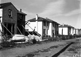 Picture relating to Reid - titled 'Row of two story semi detached houses, under construction, Booroondara Street, Reid.'