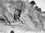 Picture relating to Mugga Quarry - titled 'Quarrymen operating an air drill preparing blast holes at Mugga Quarry'