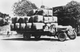 Picture relating to Winton - titled 'De Dion Bouton truck loaded with wool bales, Winton, Queensland, 1922'