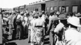 Picture relating to Mount Isa - titled 'Crowds on the Mt Isa Station platform, September 1932'
