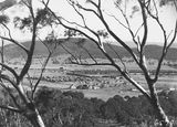Picture relating to Braddon - titled 'Braddon from Mt Ainslie to Black Mountain, Ainslie Hotel, Limestone Avenue in the centre.'