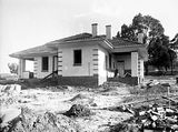 Picture relating to Parkes - titled 'Oakley and Parkes houses under construction, Blandfordia (now Forrest).'