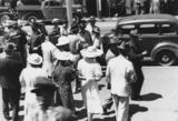 Picture relating to Brisbane - titled 'Crowds outside Supreme Court, Brisbane, waiting for decision on election appeal, 1938'