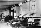 Picture relating to Queensland - titled 'Reading on the deck of a ship, 1890-1900'