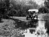 Picture relating to Canungra Creek - titled 'Car fording Canungra Creek, ca. 1925'