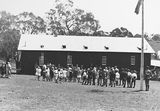 Picture relating to Ainslie - titled 'Opening of Mt Russell School, Canberra. Building was relocated from Ainslie.'