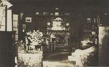 Picture relating to Boonah - titled 'Informal sitting room at Coochin Coochin, ca. 1920'