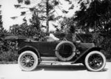 Picture relating to Queensland - titled 'Man driving a 1912 Cadillac tourer'