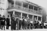 Picture relating to Rockhampton - titled 'Large group of men and boys gathered in front of River Chambers at Rockhampton, Queensland, ca. 1926'