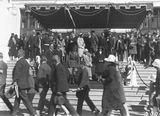 Picture relating to Parliament House - titled 'Royal Visit, May 1927 - Canberra citizens passing the Royal Party on the front steps of Old Parliament House at the Civic Reception.'