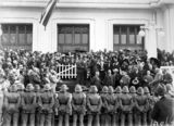 Picture relating to Bruce - titled 'Presentation of cheque and cigarette case to Bert Hinkler by Prime Minister S. M. Bruce in front of Old Parliament House with Royal Military College Cadets and spectators.'
