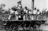 Picture relating to Gatton - titled 'Children on a decorated, festive wagon, Gatton, Queensland, 1900-1910'