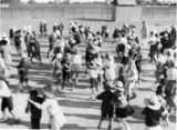 Picture relating to Longreach - titled 'School children learning to dance, Longreach, Queensland, ca. 1928'
