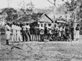 Picture relating to Queensland - titled 'South Sea Islanders outside a plantation building, ca. 1870'