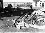 Picture relating to Braddon - titled 'Laying a driveway for a Garage in Mort Street Braddon. Canberra Times Office and Post Office in background.'
