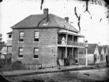 Picture relating to Brisbane - titled 'Menzies Boarding House on the north face of Edward Street, Brisbane, ca. 1872'