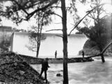 Picture relating to Cotter Dam - titled 'Cotter Dam spillway and stilling pond with three trout fishermen'