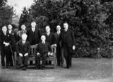Picture relating to Isaacs - titled 'Executive Council at Government House, Yarralumla. Seated, Prime Minister Joe Lyons and Governor General Sir Isaac Isaacs, Standing includes Archdale Parkhill, Bracegirdle, Finlay, Starling.'