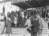 Picture relating to Canberra - titled 'Royal Visit, May 1927 - Canberra citizens passing the Duke and Dutchess of York on the steps of Old Parliament House at the Civic Reception.'