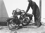 Picture relating to Queanbeyan - titled 'Accident between a Douglas motor cycle and a motor car, Lenane Road, Queanbeyan. The wrecked motor cycle.'