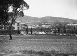 Picture relating to Parliament House - titled 'West Block Offices, Hotel Canberra and Albert Hall from behind Old Parliament House.'
