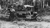 Picture relating to Queensland - titled 'Walter Duhs beside a truck loaded with bananas, 1925'