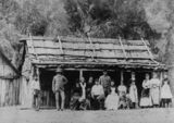 Picture relating to Queensland - titled 'Family group posing in front of rough, bush dwelling, 1879-1880'