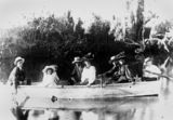Picture relating to North Eton - titled 'Group of men, women and children rowing across Lagoon Creek at Beldan's, North Eton, Queensland, 1900-1910'
