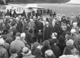 Picture relating to Pearce - titled 'Visit of Imperial Airways Airliner ASTRAEA on a survey flight for proposed air mail service Distinguished visitors being formally welcomed by Sir George Pearce, Minister for Defence.'