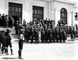 Picture relating to Parliament House - titled 'Empire Parliamentary Association delegates on the steps of Old Parliament House - Canberra Boy Scouts providing Guard of Honour'