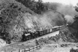 Picture relating to Mount Morgan - titled 'Rockhampton mail train ascending the Razorback near Mt. Morgan, 1910'
