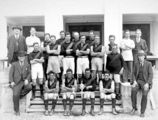 Picture relating to Acton - titled 'Acton Australian Rules team with officials'