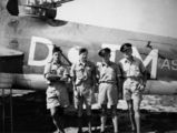 Picture relating to Queensland - titled 'Four Air Force members standing casually with their aeroplane'
