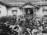 Picture relating to Charleville - titled 'Large crowd outside the railway station, Charleville, ca. 1920'