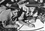 Picture relating to Caloundra - titled 'Two young soldiers plotting the board at Caloundra, 1940'